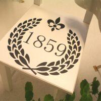 1859 i olivenkrans og fransk lilje