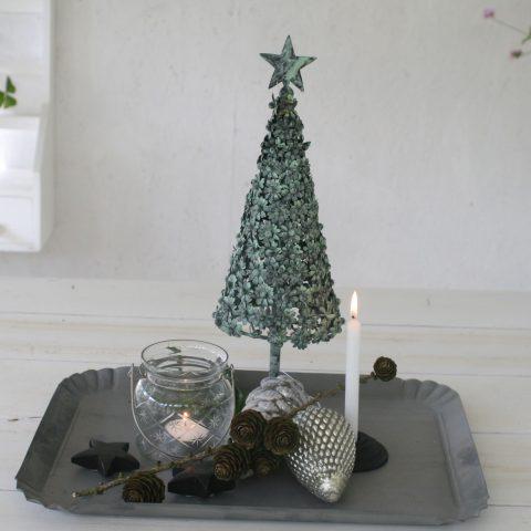 Juletræ med små blomster i antique verte